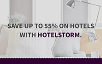 "Photo of hotel room bed: ""Save up to 55% on hotels."""
